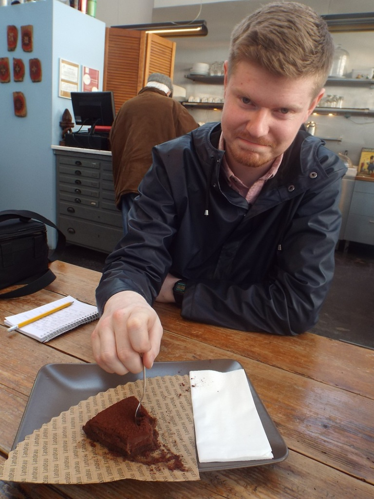 Conor McMahon of Travel Extra tucks in to a piece of Landeau chocolate cake